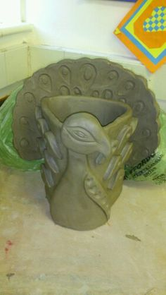 beautiful peacock pot...airdry clay for us.... great lesson on texture and how to use the clay tools