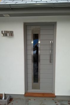 "This contemporary door looks great with it's stainless steel glazing trim and square section pull handle. Finished in Little Greene Pains ""Lead Colour"""