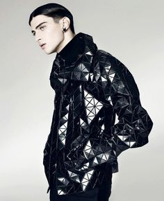 A most interesting futuristic jacket... but the model looks like a gay version of Rowan Atkinson who's joined an obscure order of monks...