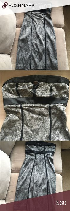 """Gray and Black Cocktail Dress Bebe gray and black strapless cocktail dress. Paisley print. Has small triangle cut out detail on chest. Approx 31"""" in length. 17"""" width. Slit in back is 7.5"""". Dress is like new -- no rips, tears, picks in fabric, etc. bebe Dresses Strapless"""