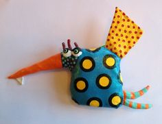 Made from upcycled fabrics, sewn into fun critters, stuffed with Walmart bags, gessoed, and hand painted. Has the look and feel of leather. Size: 8