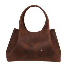 Handtas!Materiaal: dik, stevig chocoladebruin ;leder.Kenmerken: pure tas zonder voering, uitneembare binnentas ;afsluitbaar met rits.