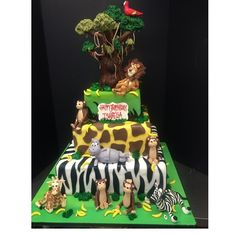 Madagascar cake! #madagascarcake #edibleanimals #zebraprint #lion #safari #awesomecakes #fondantcakes #jungle #monkeys #satisfiedcustomers #giraffe 🐯🐒🐵🐘🐨🐅🌲