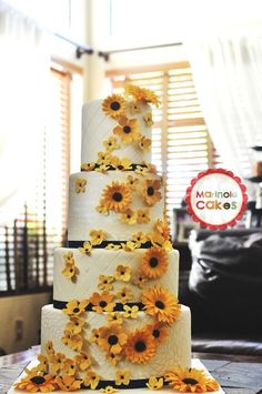 Trimmed with golden daisies and blossoms. This is a cake full of sunshine for a wedding by the bay. It drove all the way to San Francisco from my place in San Diego. Moist vanilla cake, Mango vanilla cake, with vanilla bean buttercream covered in fondant. Summer Wedding, Our Wedding, Dream Wedding, Wedding Ceremony, Sunflowers And Daisies, Gerber Daisies, Sunflower Cakes, Sunflower Wedding Cakes, Sunflower Party