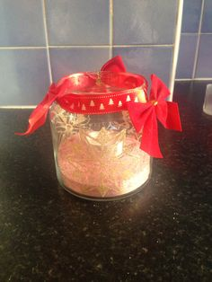 Yankee jar decorated with window stickers, ribbon and bows.I used salt+glitter for the snow.