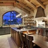 Whip up everything from comfort food to gourmet meals in the beautiful Old World-style kitchen of this 5,425-square-foot Tuscan house. Located in Indio, Calif., the automated smart home is a stone's throw from where the Coachella music festival is held, as well as close to a golf course, polo fields and an airport. See more at HGTV FrontDoor.com. | HGTV FrontDoor