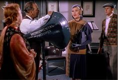 """Jean Hagen  as Lina Lamont while attempting to sing """"Would You?"""" in Singin' in the Rain (MGM, 1952)."""