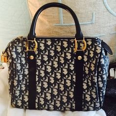 "Christian Dior ""Trotter"" Boston Handbag 100% Authentic. Beautiful Christian Dior in excellent condition. Navy CD canvas pattern with Gold emblems and zippers! Comes with lock and dustbag. Dior Bags Totes"