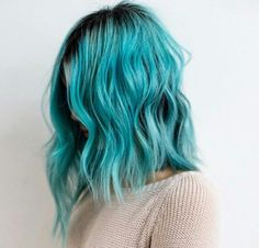 I want to do a lighter blue this time and I LOVE this I'm def doing aqua with maybe my roots at the top cause they're dark enough like the picture. Or maybe a little darker blue at the roots idk but I like this color