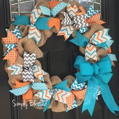 This wreath combines 2 favorite trends....burlap and trendy ribbons! The wreath is the perfect size for your front door or to use as an accent in your home. This makes a great gift!  It comes in 2 sizes .... approximately 18 or 22 wide. If you want a large initial in the center of the wreath select that option. Please let me know the color of the initial in a note at checkout. Other colors and sizes can be designed for you as well. Message me today! Ribbons may vary slightly in style from…