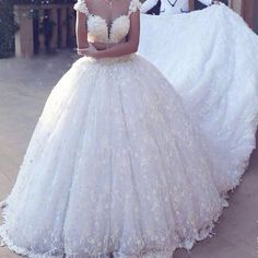 A cap sleeve ball gown style is great for a wedding dress.  Custom #weddingdresses & #replicas of couture designer gowns can be made by our US firm for less than you think.  If your dream dress is way out of your price range email us images for pricing.  DariusCordell.com