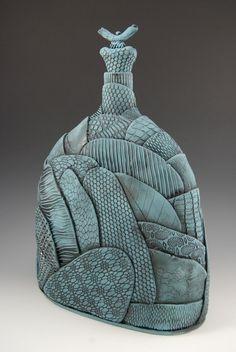 Blue texture ceramic flask. Patchwork field design.
