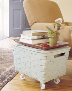 big basket on castors for end table . Great Idea ! There are so many different styles of baskets to choose from & match with any style decor .