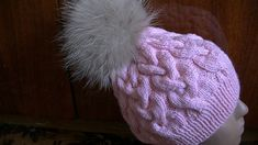 Вязание шапки с большими косами.Knitting hats with big braids