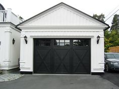 Did you remember to shut the garage door? Most smart garage door openers tell you if it's open or shut no matter where you are. A new garage door can boost your curb appeal and the value of your home. Black Garage Doors, Carriage Garage Doors, Diy Garage Door, Modern Garage Doors, Garage Exterior, Garage Door Design, Black Doors, Garage House, Garage Ideas