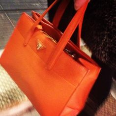 In love with this orange Prada Handbag we spied on the streets of London. #HandbagSpy www.handbag.com