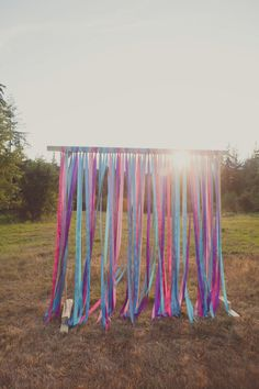 Ribbon alter backdrop (wonder if we could construct something portable to move to ceremony site?  maybe on curtain rods?)