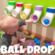 Ball Drop using pvc pipe. I put different colored tape around the top of each to match the colors of the ball pit balls we have, so that we can eventually use this to work on identifying colors too!No long tube for this to get stuck in! Infant Activities, Activities For Kids, Baby Room Activities, 5 Month Old Baby Activities, Toddler Airplane Activities, Childcare Activities, Toy Rooms, Toddler Fun, Toddler Rooms