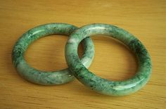 Very fine and extremely rare pair of jadeite jade bangle bracelets. They are NATURAL UNTREATED - GRADE A. This is a very rare matching pair that were cut from the same jade stone rough. Very hard to find.