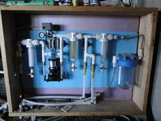 Earthship Biotecture's Water Organization Module (WOM).  This is what filters rainwater into drinking and washing water.