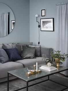 Cosy Scandinavian living room, with interior decor in shades of grey and blue. Living Room Decor Grey And Blue, Living Room Colors, Living Room Paint, Living Room Interior, Living Room Designs, Living Rooms, Bolia Sofa, Living Room Inspiration, Home And Living