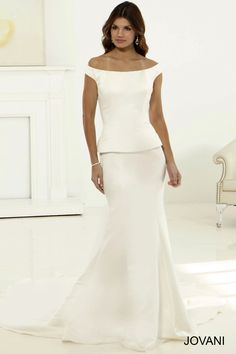 #Jovani #Bridal JB2346 features an off the shoulder fitted bodice with a chic peplum skirt that will undoubtedly have all eyes on the bride. http://www.jovani.com/wedding-dresses/jb2346 #WeddingDress #BridalGown