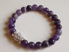 Amethyst  Beaded Bracelet with Silver and Crystal feature beadsA classy look for that special outfit with a little sparkle to add interestAmethyst is used for problems in the blood and in breathing problems. Amethyst crystal clusters are used to keep the air and life force in the home clean ...