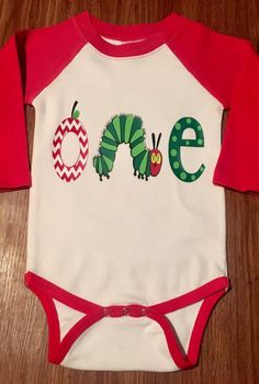This adorable Very Hungry Caterpillar bodysuit is perfect for a first birthday party! The bodysuit is white with red sleeves and the sleeves are long sleeve **NOT** 3/4 sleeve. Short sleeve available upon request.