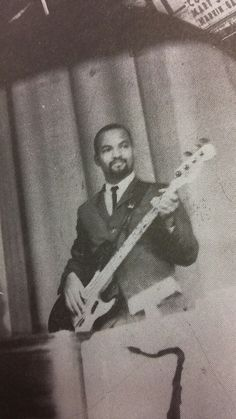 """James Jamerson with his first Fender Precision Bass (57 maple neck) called """"Black Beauty""""."""