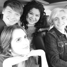The Austin and Ally cast while Ross shows them R5's new single,'Smile'