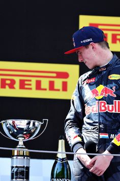 Max Verstappen, Red Bull Racing looks at his trophy