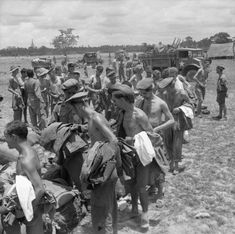 Liberated POWs abandoned by the Japanese at Pegu and rescued by the advancing 14th Army queuing for new kit, 3 May 1945.