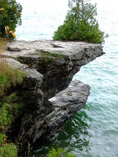 Cave Point, County Park, Door County, Wisconsin, USA. Located within Whitefish Dunes State Park, this county park features picturesque limestone sea caves, the result of Lake Michigan's relentless pounding against the limestone bluffs. While the sea caves are the big draw, the 19-acre park also features a tranquil half-mile hiking trail and is a haven for a wide variety of birds.