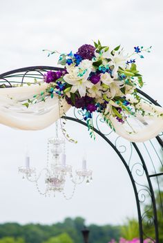 Wedding Arch With Purple and Blue Flowers and a Candelabra | Mary Sarah Photography https://www.theknot.com/marketplace/mary-sarah-photography-frederick-md-766579 | The Links at Gettysburg | Ory Custom Florals https://www.theknot.com/marketplace/ory-custom-florals-new-market-md-304700
