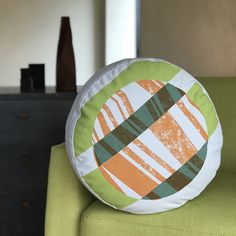 Round Box Cushion 'Tectonic GO' Aly Storey Handprinted Textiles £65.00 Limited edition print on linen made up into round box cushion, includes feather pad. Hand screen printed with three colours on BOTH sides, printed on 100% pale grey cotton. Using soft to the touch textile inks. Removable, zipped cushion cover. Weight: 1.35 kg Dimensions: 43 x 43 x 22 cm