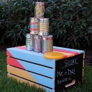 Tin Can Toss Backyard Game — Transform a wood crate and empty tin cans into a fun backyard game. Tin Can Toss Backyard Game — Transform a wood crate and empty tin cans into a fun backyard game. Family Fun Games, Games For Kids, Diy For Kids, Activities For Kids, Crafts For Kids, Backyard Play, Backyard For Kids, Backyard Games, Outdoor Games