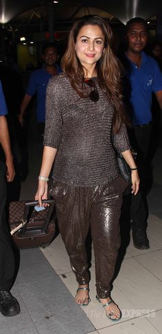 Amrita Arora was shimmering in a brown top with dhoti pants at Mumbai airport. #Bollywood #Fashion #Style #Beauty