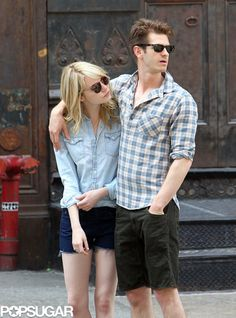Andrew Garfield and Emma Stone Walk Hand in Hand Into the Weekend: Andrew Garfield put his arm around Emma Stone.