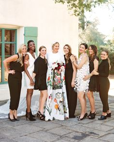 """Bridesmaids chose among black and cream outfits. """"I didn't want them to look the…"""