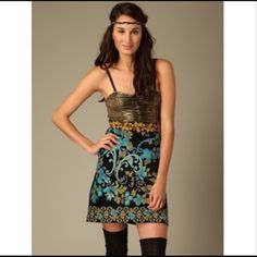 """Free People Lost in Paradise Dress Lightweight smocked lamé bust. Elasticized smoking at side bust. Can be worn strapless or with adjustable removable shoulder straps. Floral velour jacquard empire waist banding. Mid-weight floral printed cotton velvet skirt; plain back. Unlined. Side invisible zip closure. Measures approximately 15"""" long from natural waist. Bodice 94% polyester 6% spandex; skirt 109% cotton; lining 96%nylon 4% spandex. Style #305097301. Imported. Hand wash. Namaste Free…"""