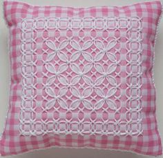 This is a PDF pattern for 2 pincushions embroidered on gingham with Australian Cross Stitch, a technique similar to Chicken Scratch. The pincushions
