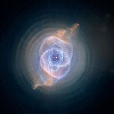Cat's Eye Nebula - The Cat's Eye Nebula features concentric shells or bubbles of gas and dust.