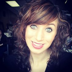 Curly hair/bangs . . . but w/o the freakishly big eyes.