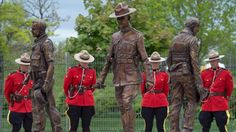 Two years after a gunman went hunting police officers in a Moncton, N., neighbourhood -- leaving three officers dead, two wounded, and families and the public to grieve -- a monument has been unveiled. Gta, Tommy Douglas, Dave Ross, Ontario, The Guess Who, Meanwhile In Canada, Canadian Things, Life Size Statues, Canadian Soldiers