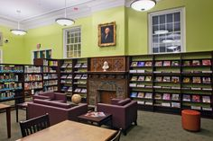 Design elements the library staff appreciates: pop of color on the walls, display shelving, fireplace, high windows.