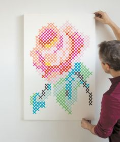 This is not your grandma's cross-stitch. These projects take the art form of stitching tiny X's with thread and turn it on its head. Giant painted cross-stitch wall murals, stitched sterling silver bangles, an embroidered Ikea stool—trust me, there's a lot more to this craft than alphabet samplers.