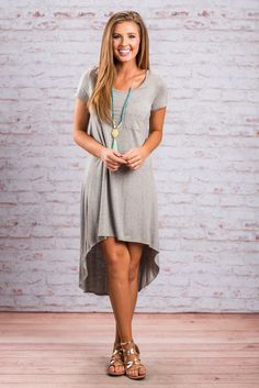 """Memorable Mentions Dress, Gray""This casual hi-lo dress is totally memorable and it worth mentioning it's super comfy! The color makes it super easy to style it with different color necklaces and shoes! #newarrivals #shopthemint"