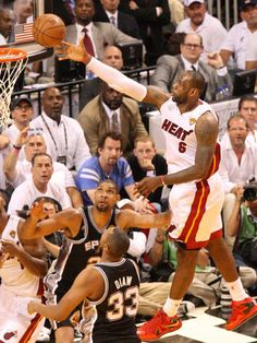 Miami Heat forward LeBron James jumps high in the air to score two ...