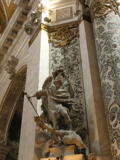 Chiesa dei Gesuiti - Venice, Italy   Angel Michael Statue by Giuseppe Torretti - Giuseppe Torretti  b. Venice 1664 - d. 1743  A sculptor, Torretti began as a stonecutter. He made the altar for San Silvestro in Venice. He made the 'Holy Family' in the Scalzi church in Venice. He completed a series of sculptures for the Udine Cathedral and a series of reliefs for the Cappella Manin at Udine. He exported works throughout Italy and to St. Petersburg, Russia. His workshop continued until 1826.