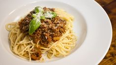 Spaghetti Bolognese by Sorted Food. I love cooking with wine and this dish offers the full flavor of a rich tomato sauce fortified best with a dry red. Enjoy!